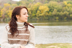 Beautiful girl enjoying the autumn weather Royalty Free Stock Photography