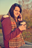 Beautiful girl enjoying coffee in park Royalty Free Stock Photography