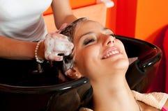 Beautiful girl enjoying hair washing Stock Image