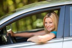 Beautiful girl enjoying her new car Stock Images