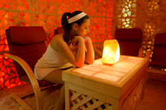 Beautiful girl enjoying her therapy in salt room Royalty Free Stock Photography