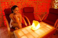 Beautiful girl enjoying her therapy in salt room royalty free stock photo