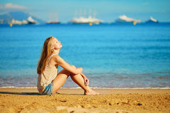 Beautiful girl enjoying her vacation by the sea Stock Photography
