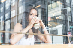 Beautiful girl enjoying an hot coffe Stock Photos