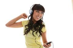 Beautiful girl enjoying music royalty free stock photography