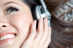 Beautiful girl enjoying music close up Stock Images