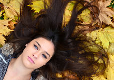 Beautiful girl enjoying nature in autumn forest Stock Images