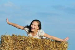 Beautiful girl enjoying the nature in the hay Stock Image
