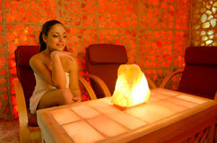 Beautiful girl enjoying salt therapy in beauty spa Stock Photography