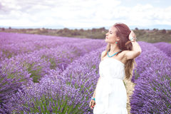 Beautiful girl enjoying the scent of lavender fields Royalty Free Stock Photography