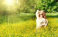 Beautiful girl enjoying the summer sun. Outdoors in the park Royalty Free Stock Photos