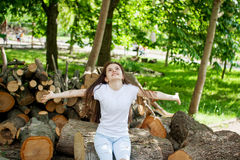 Beautiful girl enjoying the summer sun. Outdoors in the park Stock Images