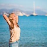 Beautiful girl enjoying the sun on beach Stock Image