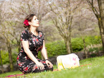 Beautiful girl enjoying the sun during a picnic in the spring Royalty Free Stock Image