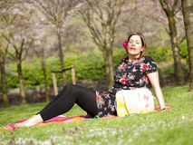 Beautiful girl enjoying the sun during a picnic in the spring Stock Photography