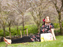 Beautiful girl enjoying the sun during a picnic in the spring Royalty Free Stock Photography