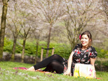 Beautiful girl enjoying the sun during a picnic in the spring Stock Photo