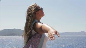 Beautiful girl enjoying the sun and sea stock video