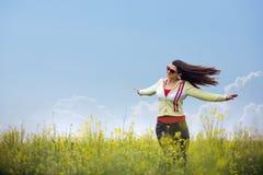 Beautiful girl enjoying the sunny day in the field Stock Photo