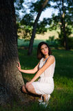 Beautiful girl enjoying sunny day in summer forest Royalty Free Stock Photography
