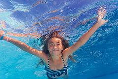 Beautiful girl enjoying swimming under water Royalty Free Stock Photography