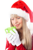 Beautiful girl enjoys a cup of hot tea Royalty Free Stock Images