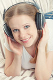 Beautiful girl enjoys listening to music Royalty Free Stock Photo