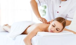 Beautiful girl enjoys massage and spa treatments royalty free stock photography