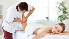 Beautiful girl enjoys massage and spa treatments Royalty Free Stock Photos