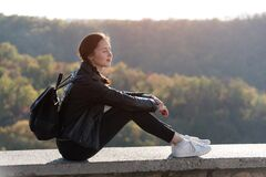 Free Beautiful Girl Enjoys Nature Sitting On A Hill With Closed Eyes. Sunny Day Royalty Free Stock Photos - 173837358