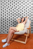 Beautiful girl enjoys sitting in the salt room Stock Image