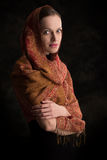 Beautiful girl enveloped in headscarf Royalty Free Stock Image