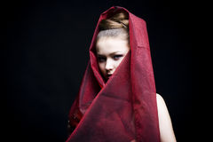 Beautiful girl enveloped  in red headscarf Stock Photo
