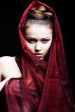 Beautiful girl enveloped  in red headscarf Royalty Free Stock Photography