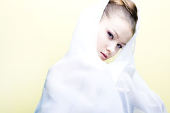Beautiful girl enveloped  in white headscarf Stock Image