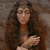 Beautiful girl in ethnic jewelry Stock Images