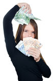 The beautiful girl with euro banknotes Stock Image
