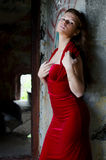 Beautiful girl in an evening dress against an old wall Stock Photos