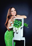 Beautiful girl in evening dress with green tulips Royalty Free Stock Photography