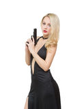 Beautiful girl in evening dress holding gun stock photo
