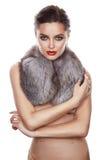 Beautiful girl evening makeup jewelry gold furs silk dress Stock Photography