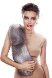 Beautiful girl evening makeup jewelry gold furs silk dress Stock Photos