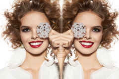 Beautiful girl with evening makeup smile take cristal snowflake Stock Photo