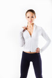 Beautiful girl in exercise outfit isolated on white Stock Photography