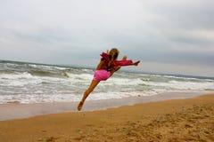 Beautiful girl exercising on coastline Stock Images