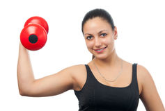 Beautiful girl exercising with dumbbell Stock Photography