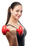 Beautiful girl exercising with dumbbell Stock Photos