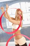 Beautiful girl exercising with ribbon Stock Images