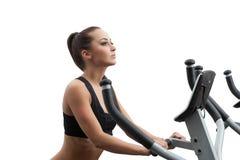 Beautiful girl exercising on stationary bike Stock Photo