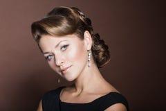 Beautiful girl with an exquisite hairdo. European;White;Caucasian, studio portrait Royalty Free Stock Images